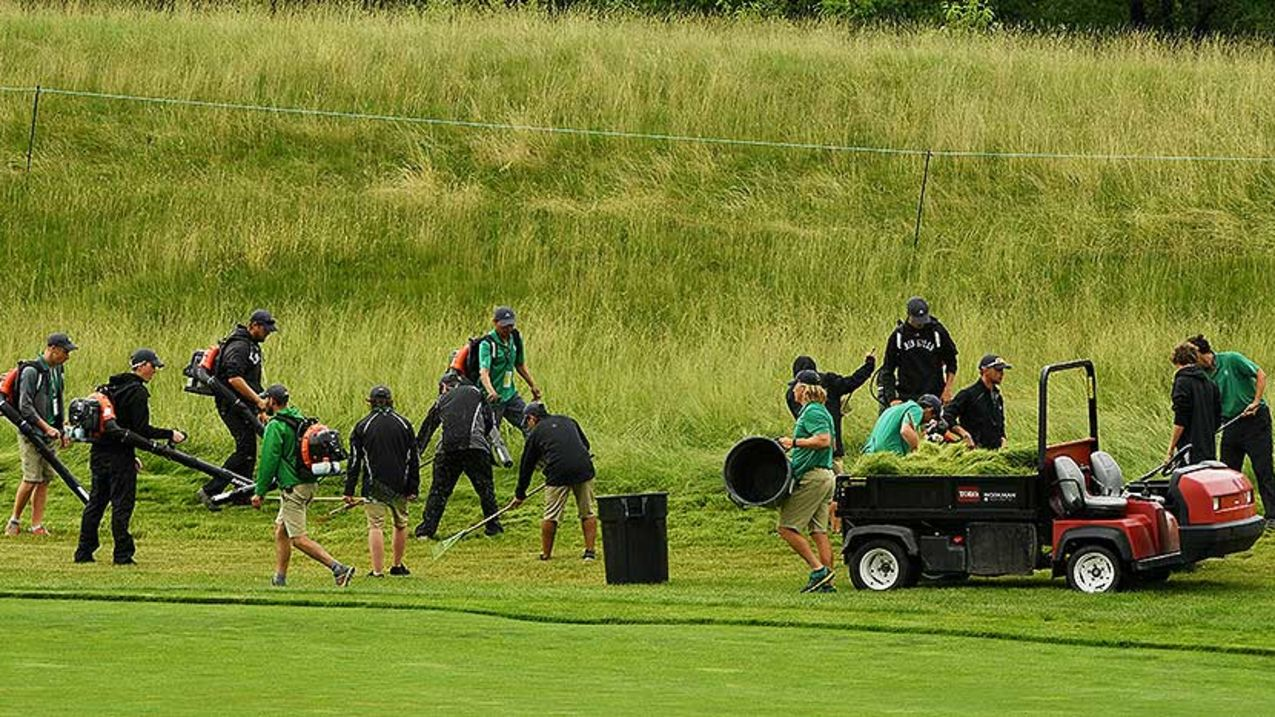 Crews cut down the fescue on four holes during Tuesday's practice rounds at Erin Hills. (Ross Kinnaird/Getty Images)