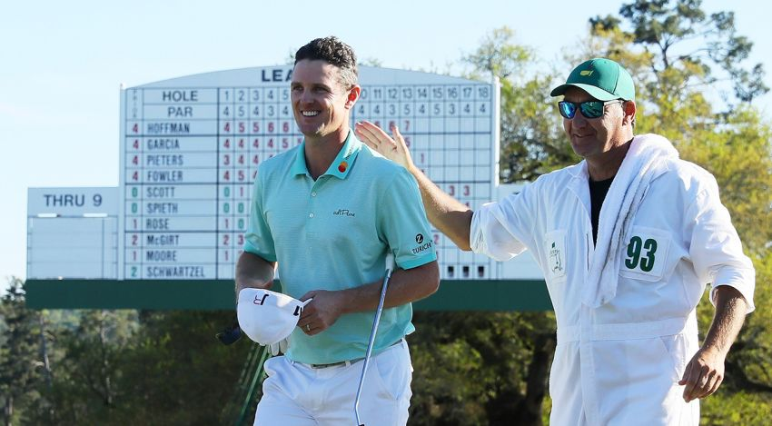 Justin Rose and caddie