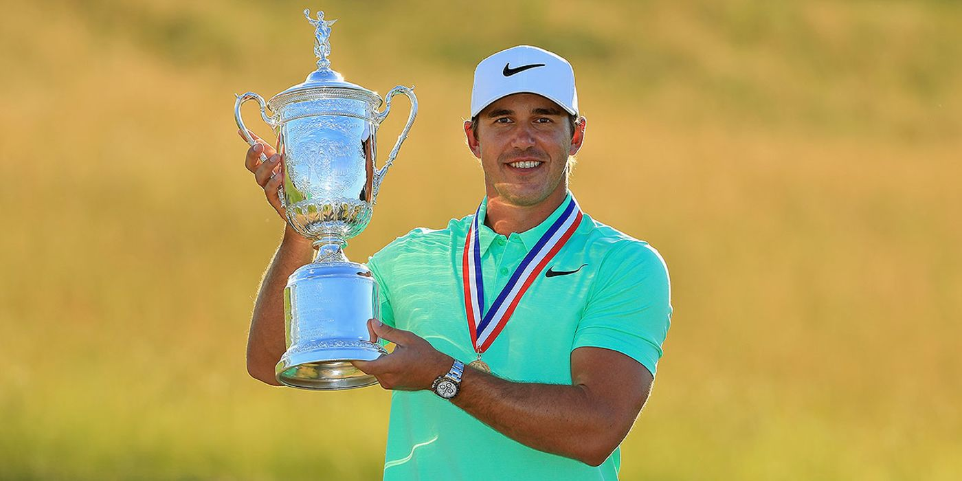 Brooks Koepka hoists US Open trophy