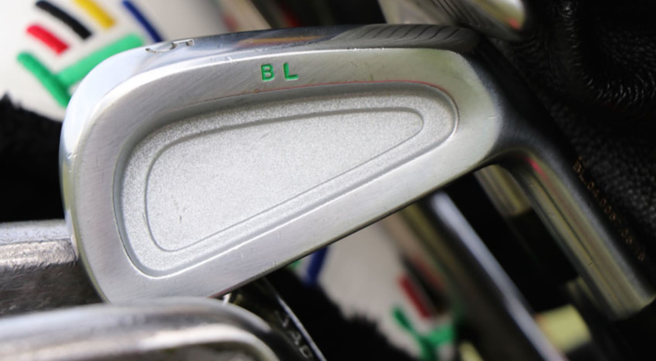 690614265827c A detailed look at a blank cavity-back 5-iron stamped with his initials