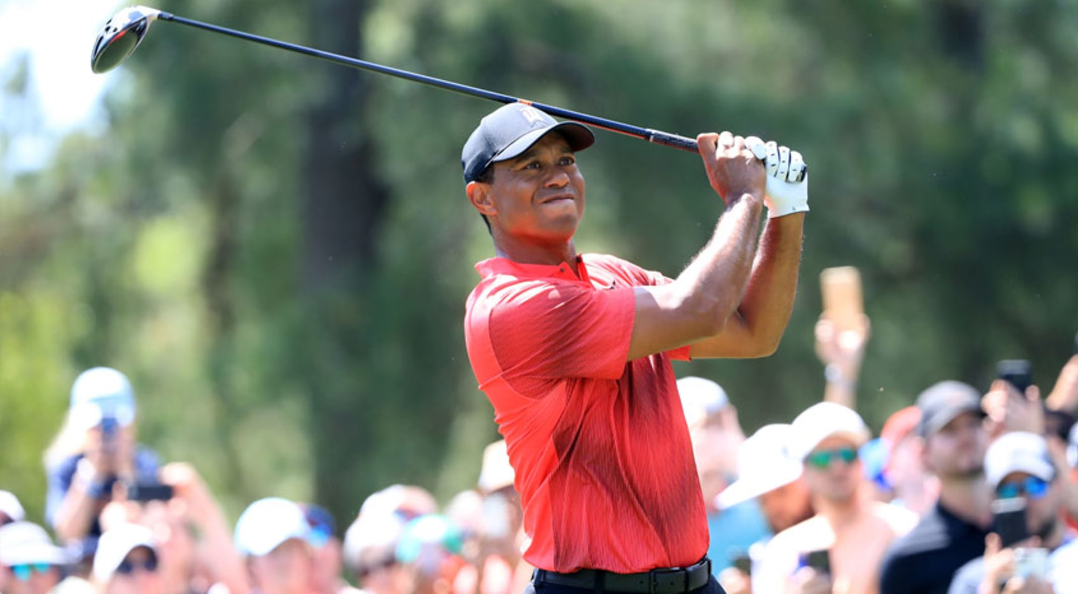 4a0934dc22407 Tiger Woods eagles No. 18 to win at the 1999 Farmers Insurance Open. Tiger  Woods will make his 2019 calendar debut ...