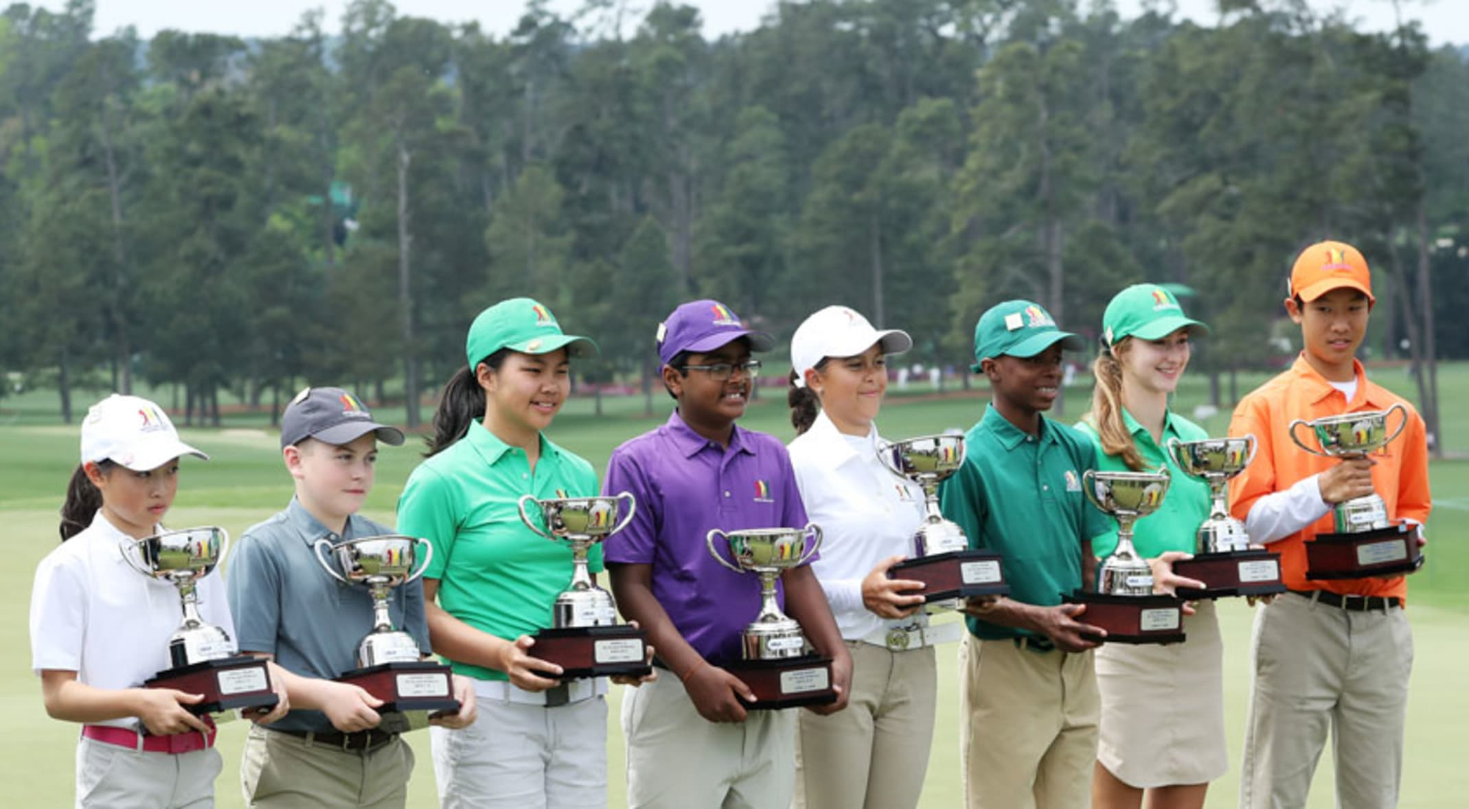36b7244f7b4c Overall winners for each division celebrate with their trophies at Augusta National  Golf Club. (