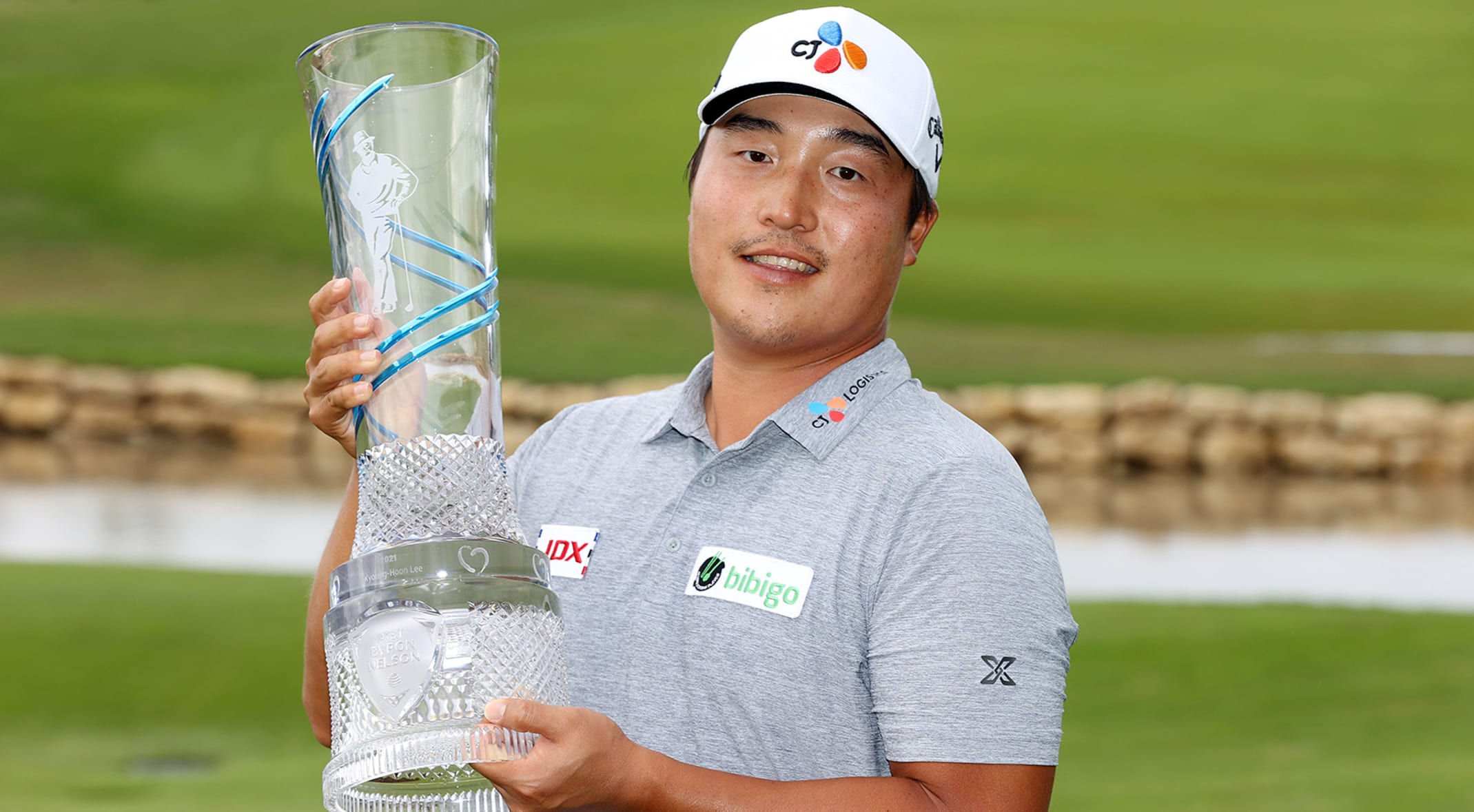 K.H. Lee with AT&T Byron Nelson trophy