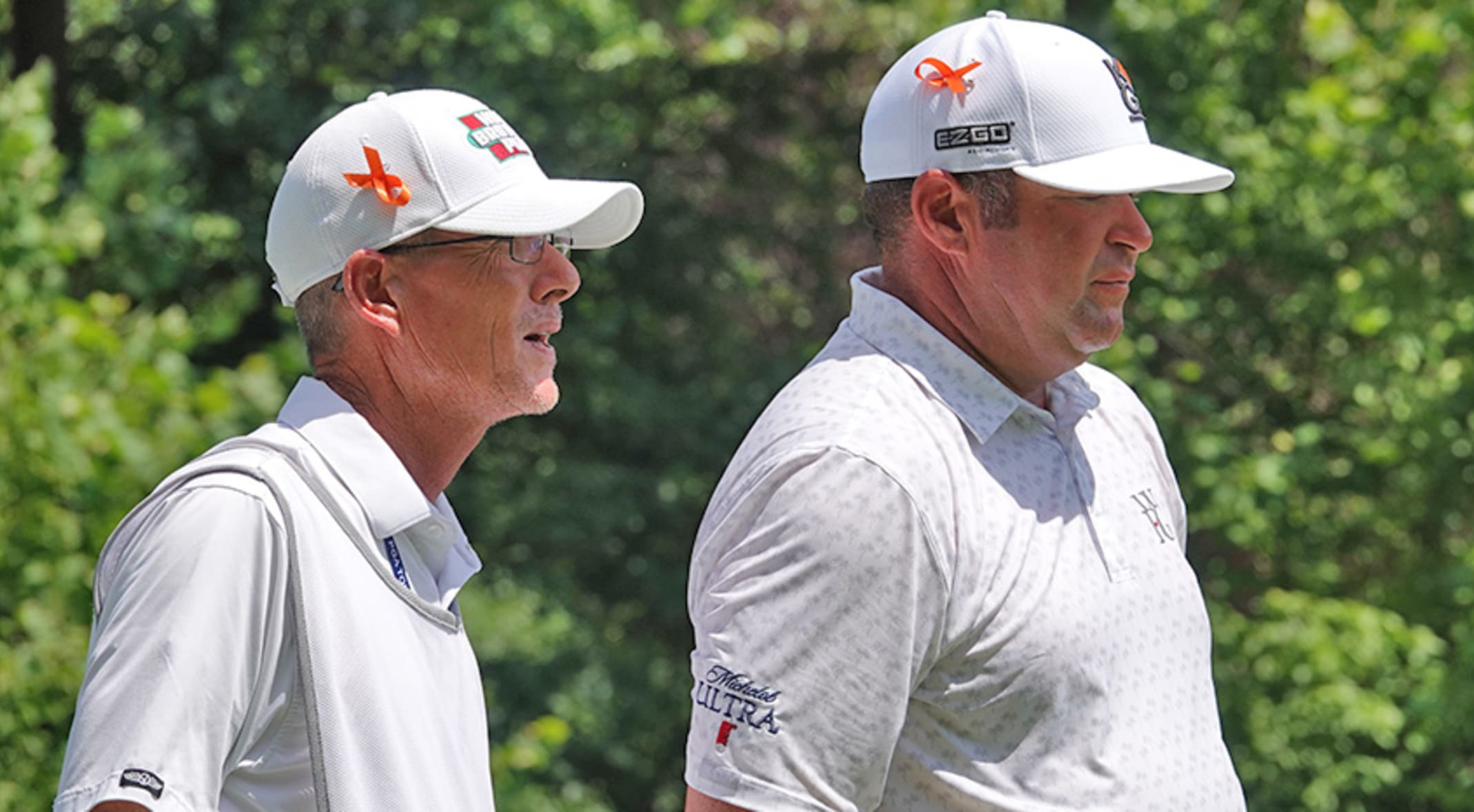 Jason Gore and his caddie wear orange ribbons to show support for Hunter  Mahan apos s 97ba08c7fb25