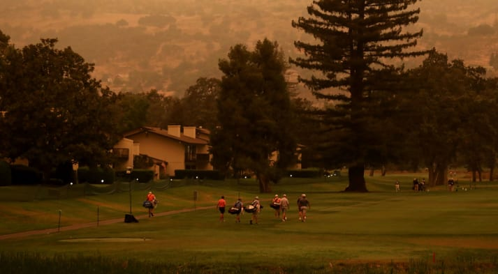 Golfers warm up on the driving range during the preview day of the Safeway Open. (Jed Jacobsohn/Getty Images)