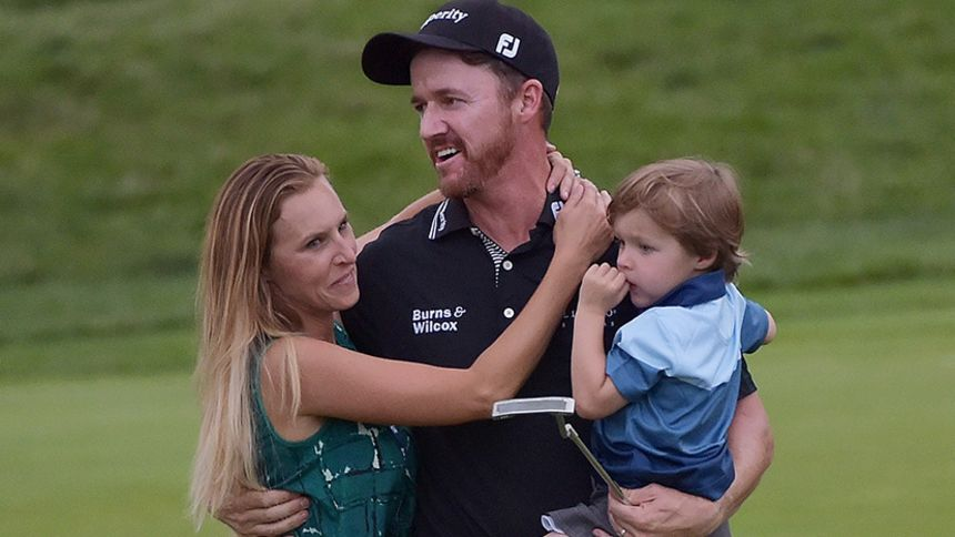 Jimmy Walker celebrates his 2016 PGA Championship with his wife Erin and son Beckett. (Drew Hallowell/Getty Images)