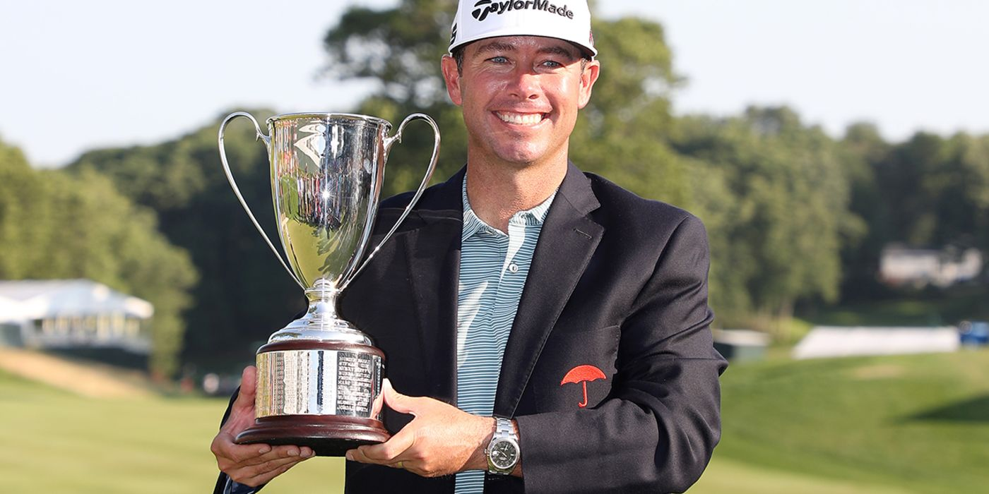 Chez Reavie with the Travelers trophy