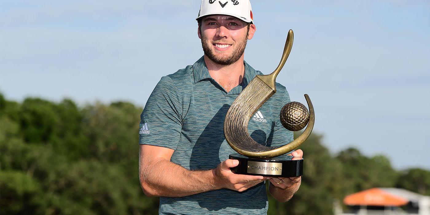 Sam Burns with the Valspar trophy