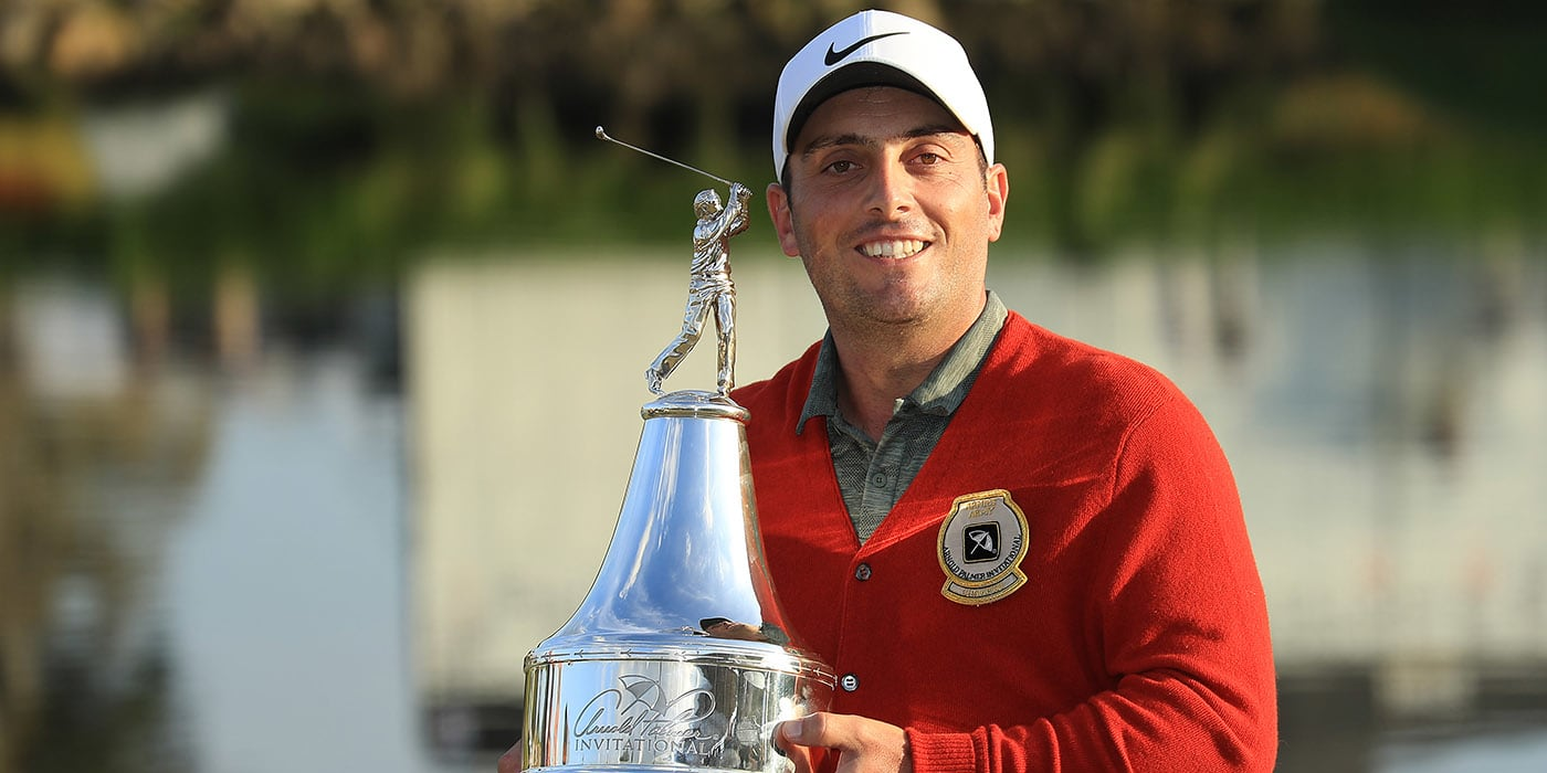 Francesco Molinari with API trophy and the Palmer red alpaca sweater