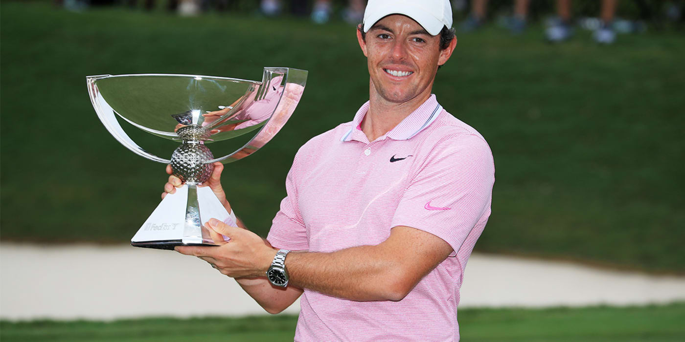 Rory McIlroy lifts the trophy