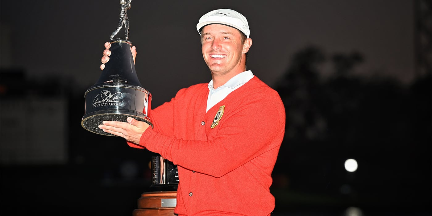 Bryson DeChambeau with API trophy and red cardigan