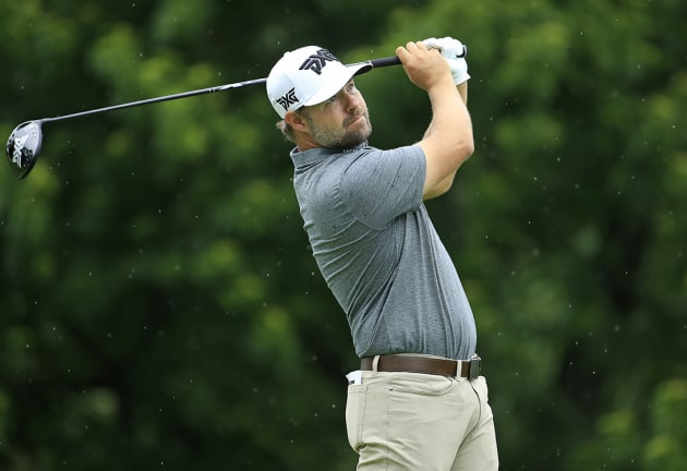 Moore takes early lead at the Memorial