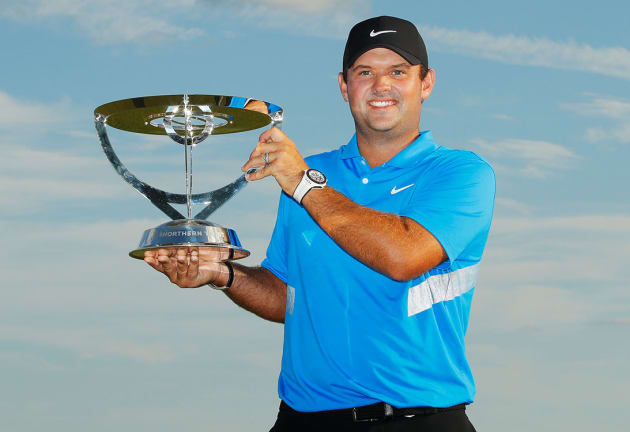 Patrick Reed with the Northern Trust trophy