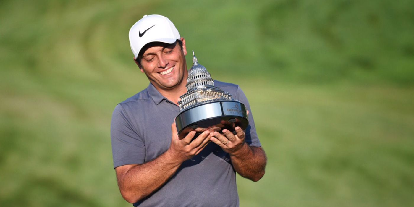 Francesco Molinari holds the Guicken Loans trophy