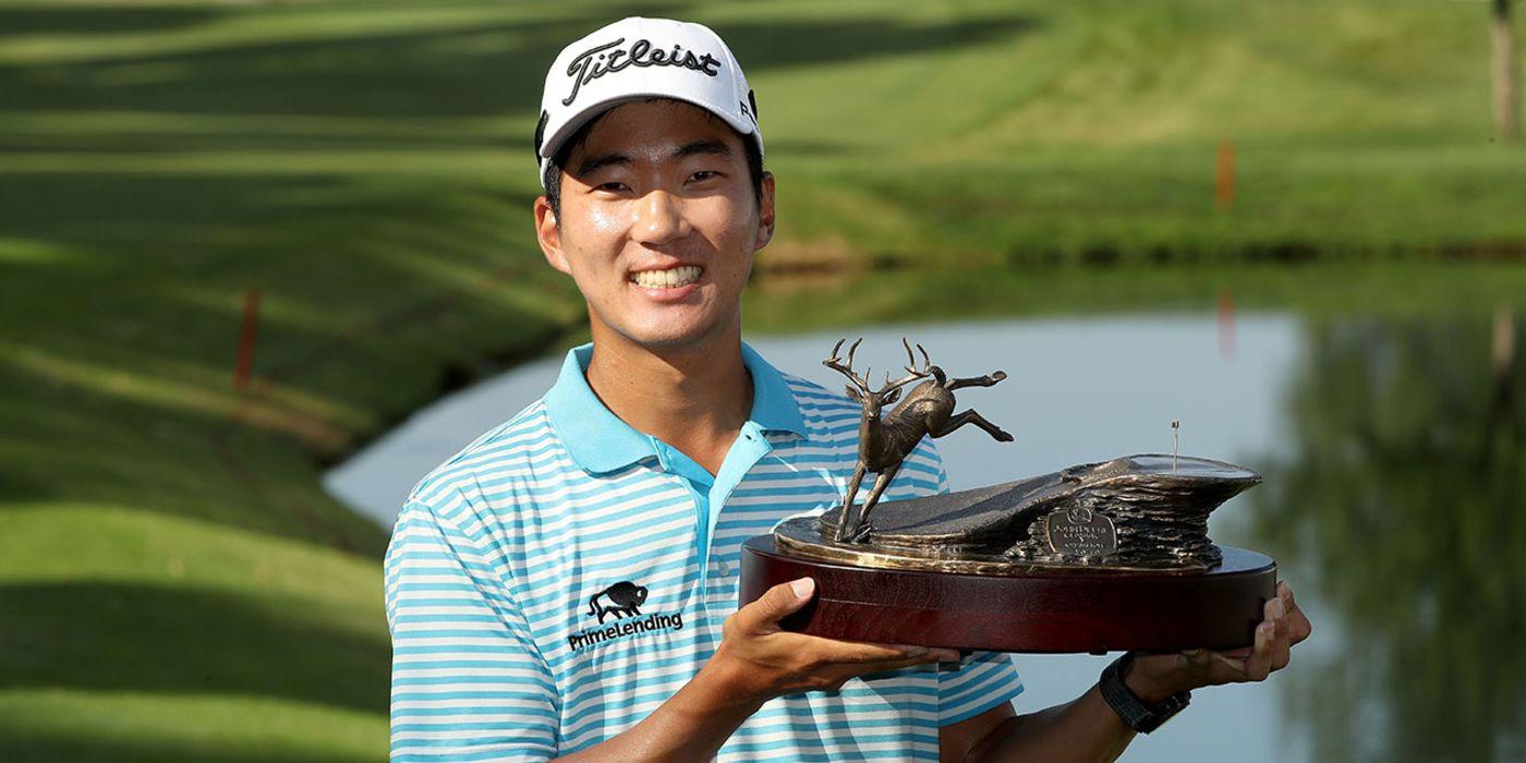 Michael Kim with Deere trophy