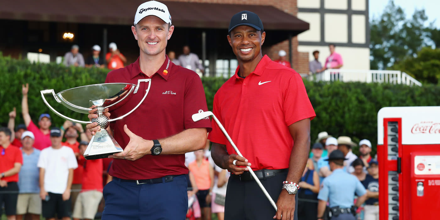 Justin Rose and Tiger with their respective trophies