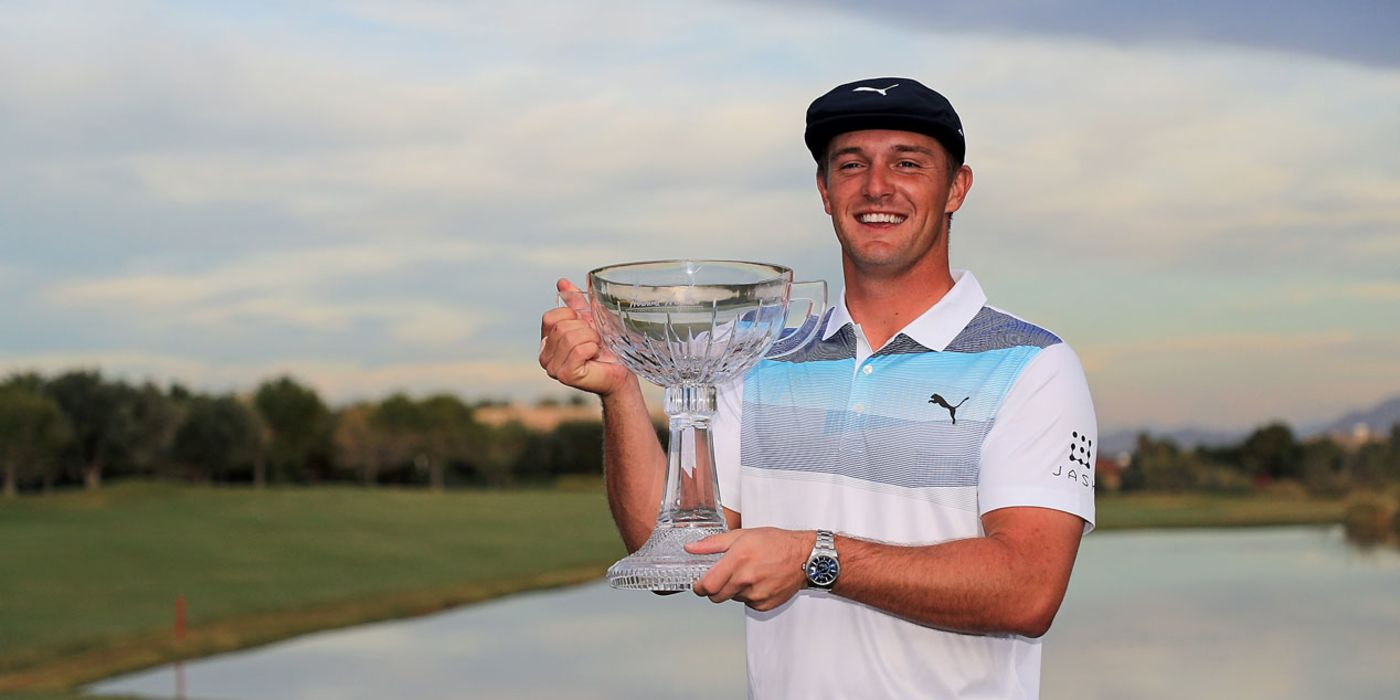 Bryson DeChambeau holds the Shriners trophy