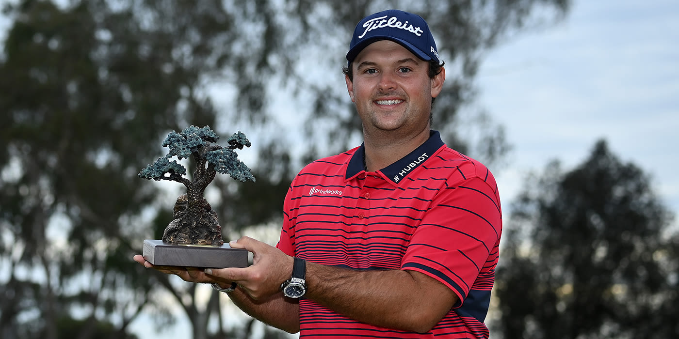 Patrick Reed with Farmers trophy