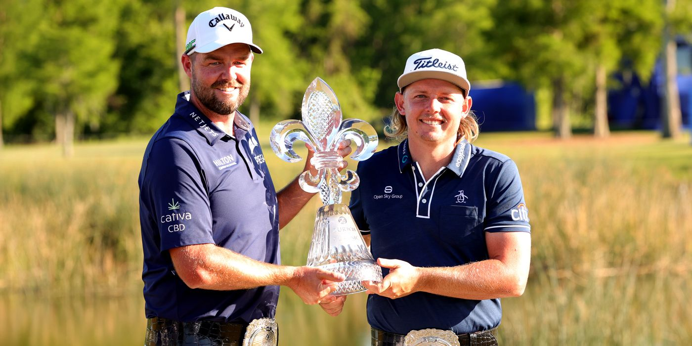 Marc Leishman and Cameron Smith with the Zurich belts and trophy