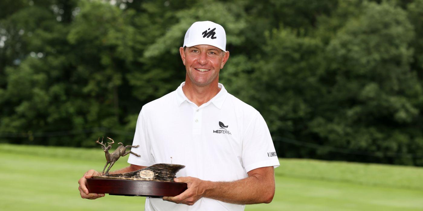 Lucas Glover with John Deere trophy