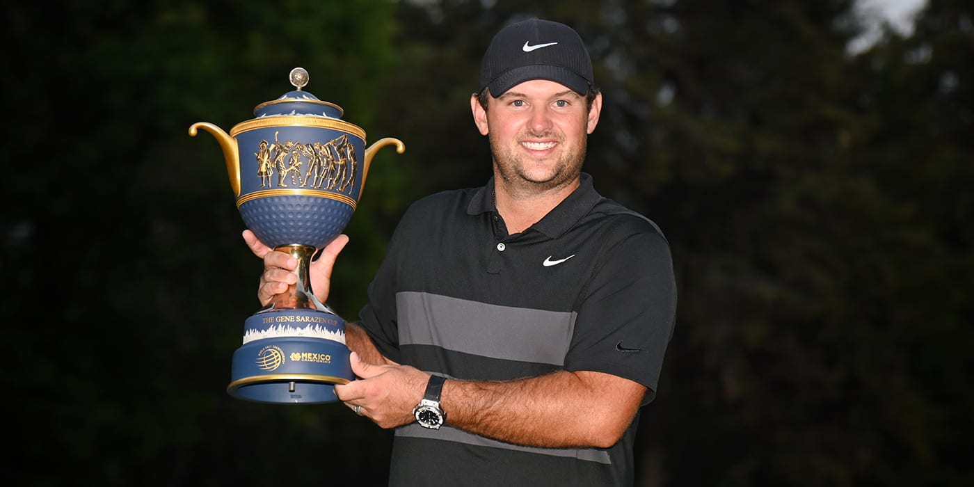 Patrick Reed with the WGC trophy