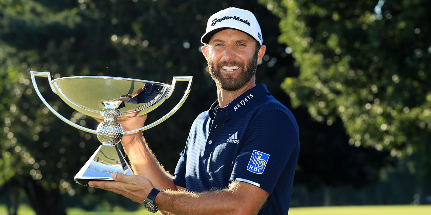 Dustin Johnson with the FedExCup trophy