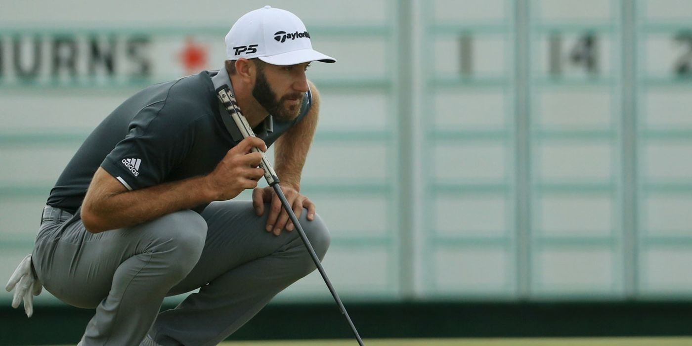 Dustin Johnson reading a putt