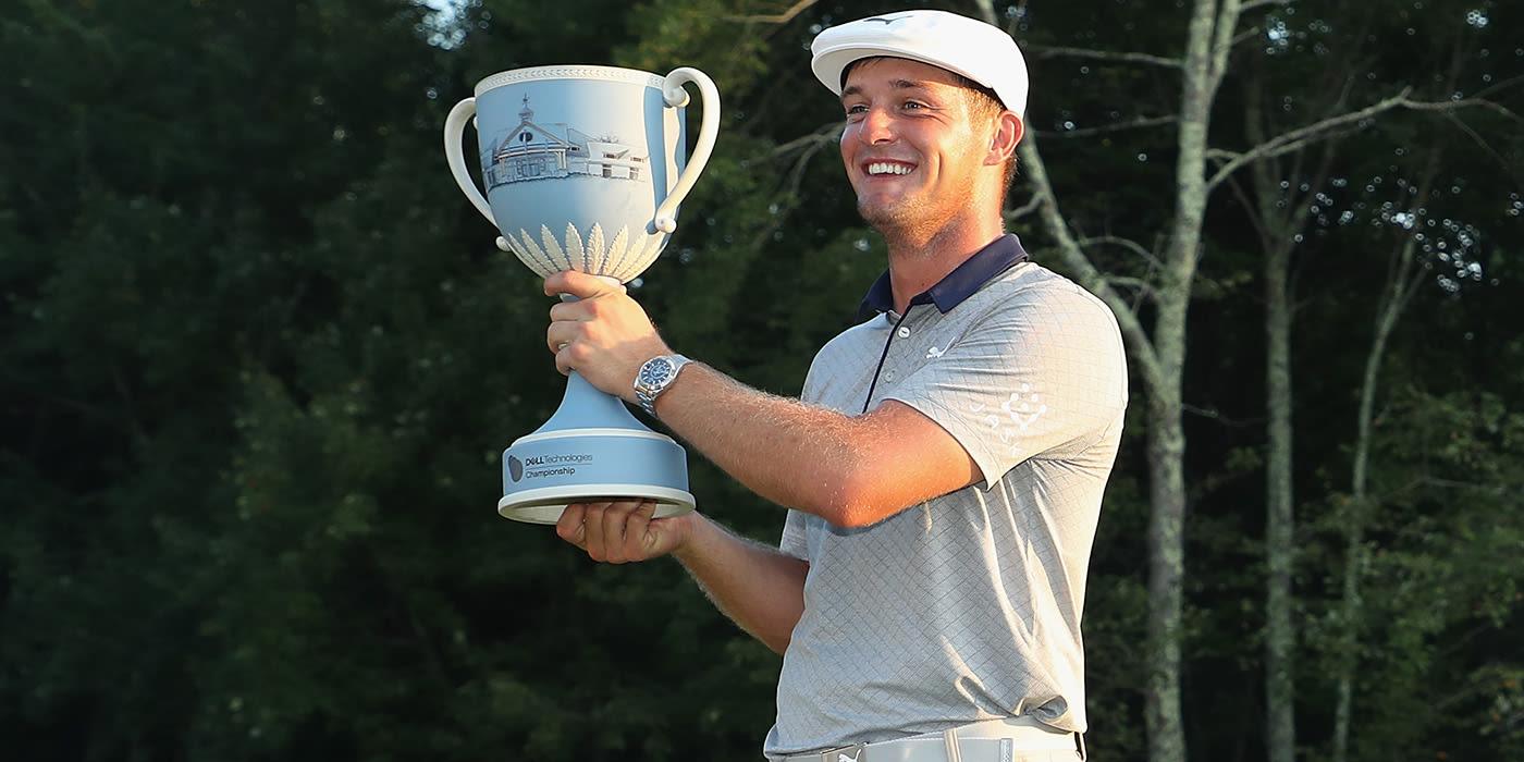Bryson DeChambeau with Dell trophy