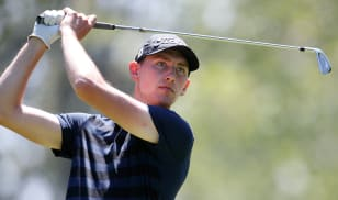 Holmes' stellar 63 gives him first-round lead at Bear Mountain