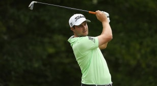 Uihlein leads after another late surge