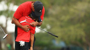 The two worlds of Tiger Woods