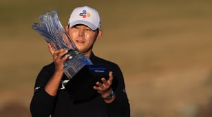 Kim closes strong to win The American Express