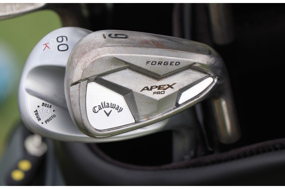 Xander Schauffele's raw Callaway Apex Pro irons, and a fresh Titleist Vokey 2018 proto K-grind wedge.